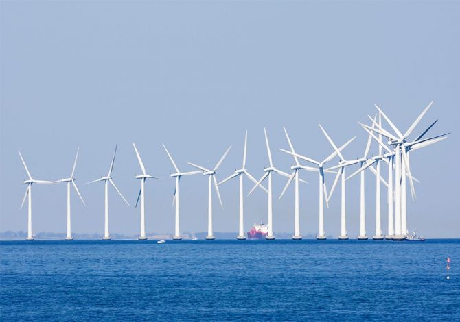A line of wind turbines in an offshore wind farm, one of the places Reflex Marine provides safe access to.