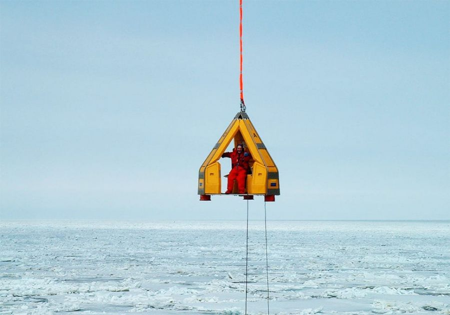 Reflex Marine FROG 3 suspended over the sea: an arctic crane transfer.