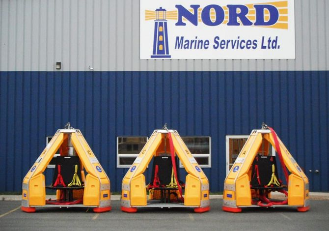 Three Reflex Marine FROG devices outside a Nord Marine Services Limited warehouse.